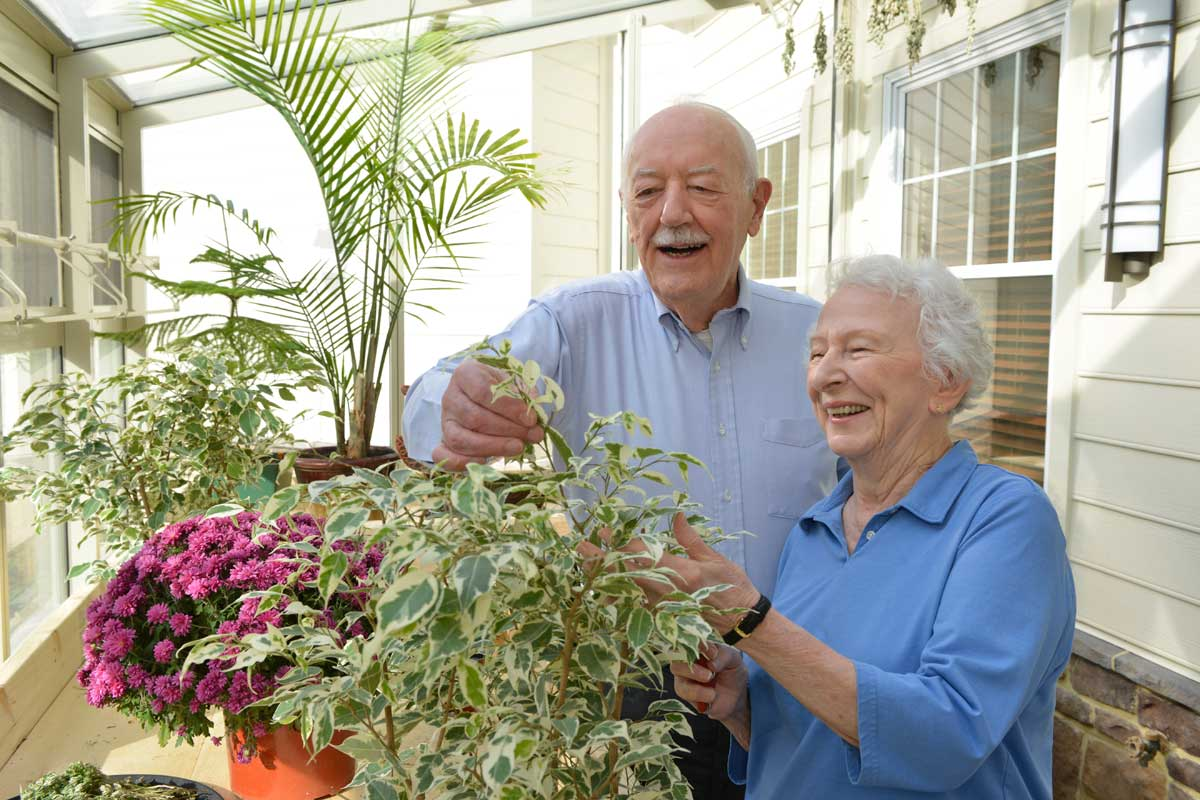 Poplar Run pastime example of senior adult woman and senior adult man tending plants